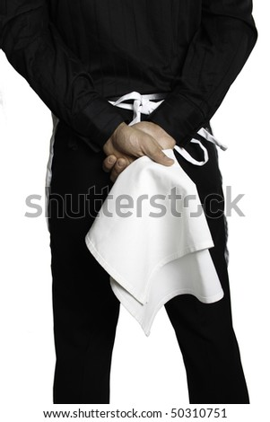 Waiter from behind from the waist up holding a white towel in his hands