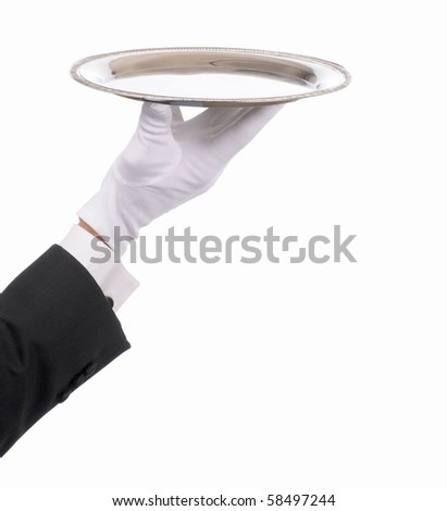 Waiter hand and arm with empty silver serving tray. Closeup of arm with tuxedo sleeve and formal white gloved hand isolated on white. - stock photo