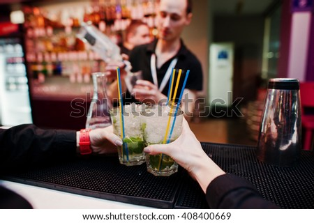 Waiter hands holding mojito coctails drink background bar man at work