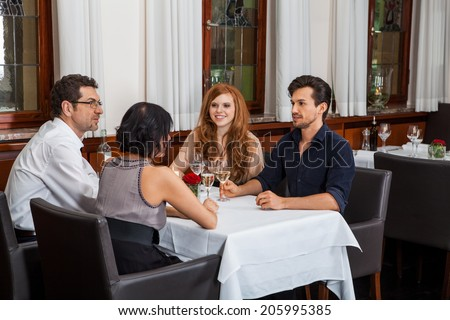 Waiter happily accommodating couple with a big smile on his face