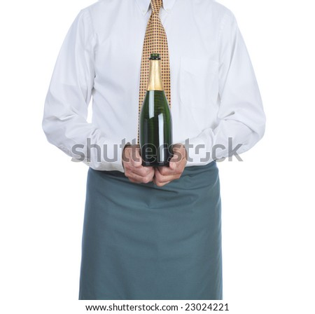 Waiter holding a bottle of Champagne isolated over white - torso only - stock photo