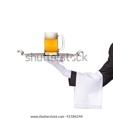 Waiter holding a silver tray with a beer mug on it - stock photo