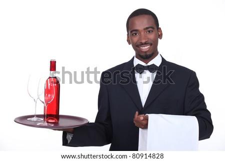 Waiter holding a tray - stock photo
