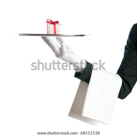 Waiter holding a tray with gift box for birthday or Christmas isolated on white background - stock photo