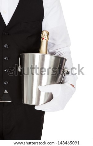 Waiter Holding A Wine Cooler With A Bottle Of Champagne - stock photo