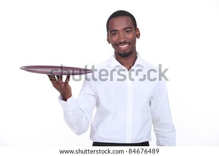 Waiter holding empty tray - stock photo