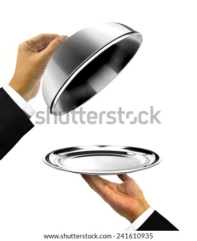 Waiter Holding Platter with Open Cover - stock photo