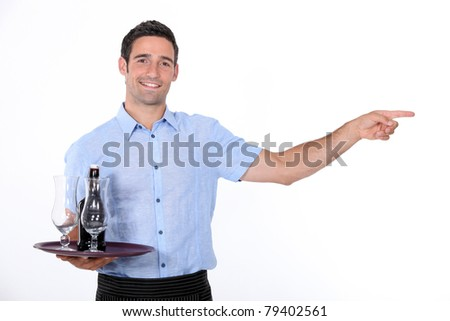 Waiter holding tray with beef bottle on it - stock photo
