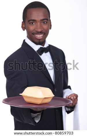 Waiter holding tray with fast food container - stock photo