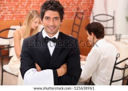 Waiter in restaurant - stock photo