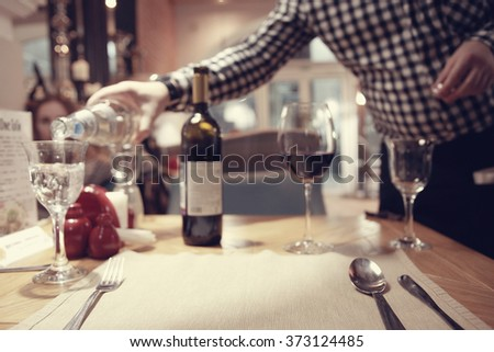 waiter in the restaurant caters - stock photo