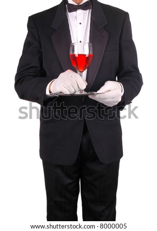 Waiter in Tuxedo Holding a Glass of Red Wine on a Tray isolated over white - stock photo