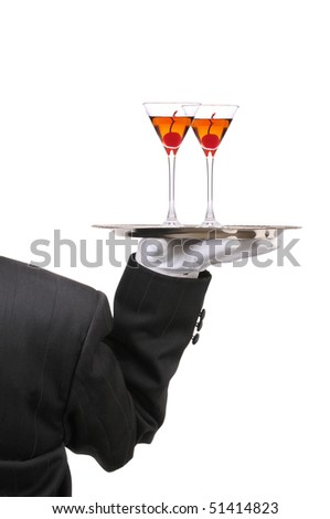 Waiter in Tuxedo seen from behind with two Manhattan Cocktails on serving tray held at shoulder height vertical format over white - stock photo
