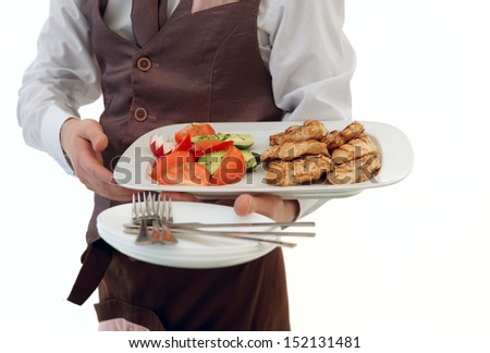 Waiter is offering meat and vegetables, isolated on white