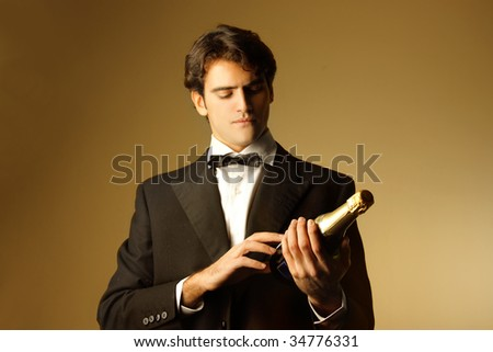 waiter looking at a champagne bottle