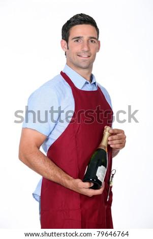 Waiter offering bottle of champagne - stock photo