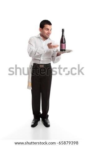 Waiter or bartender presenting a bottle on a silver platter.  White background. - stock photo