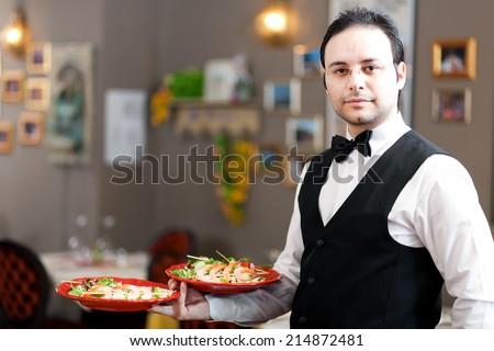 Waiter portrait at the restaurant - stock photo