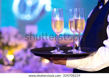 Waiter prepare Glasses of champagne for party - stock photo