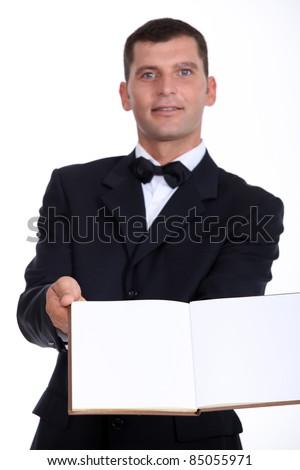 waiter reaching out menu - stock photo