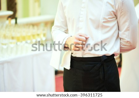 Waiter ready to service at party - stock photo