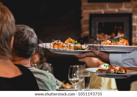 Tapas and wine stock images royalty free images vectors waiter serves dish for food and wine tasting snacks with shrimp fish fillets forumfinder