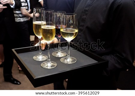 Waiter service white wine and red wine on black slate platter - stock photo