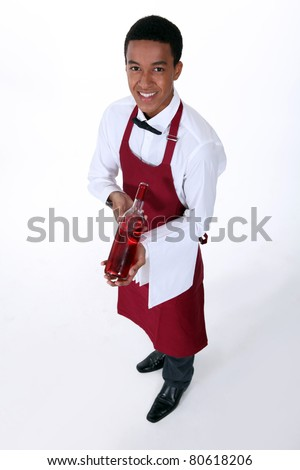 Waiter serving a bottle of rose wine - stock photo