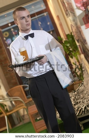 waiter serving beer and coffe in coffe bar - stock photo
