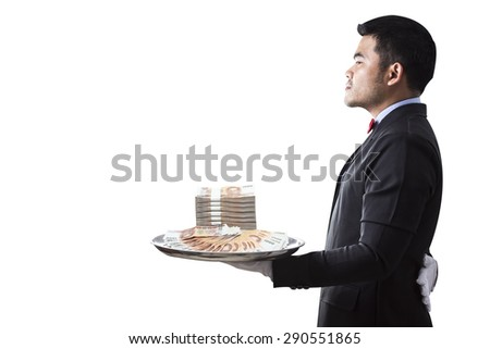 Waiter serving stack of 1,000 baht banknotes money thai  by silver tray the concept of business success property isolated on white background with clipping path - stock photo