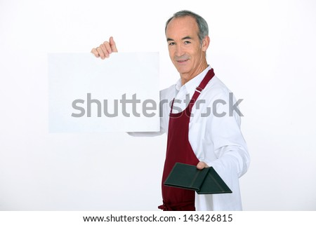waiter showing the menu - stock photo