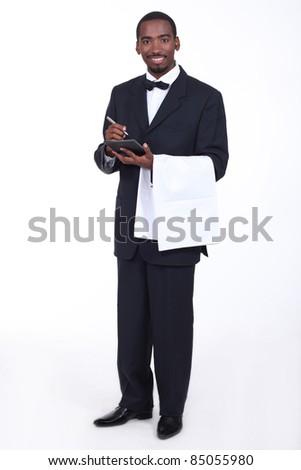 Waiter taking an order - stock photo