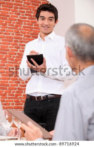 Waiter taking an order - stock photo