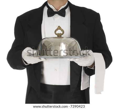 Waiter torso holding a silver tray with catering dome on a white background - stock photo