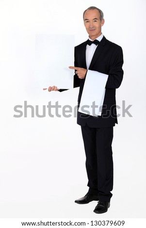 Waiter with a blank menu - stock photo