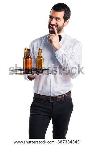 Waiter with beer bottles on the tray doing surprise gesture