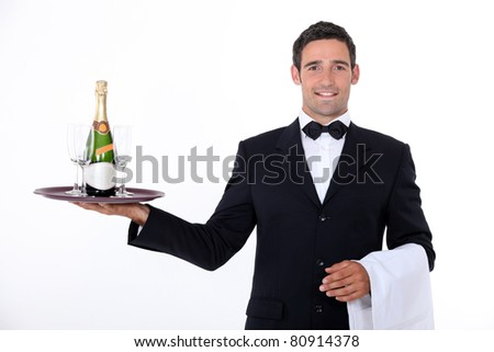 Waiter with champagne - stock photo