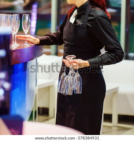 waiter with flutes - stock photo