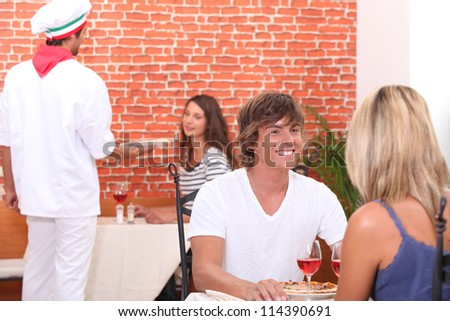 waiter working at a pizza restaurant - stock photo