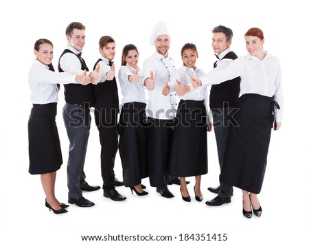 Waiters and waitresses showing thumbs up sign. Isolated on white background - stock photo