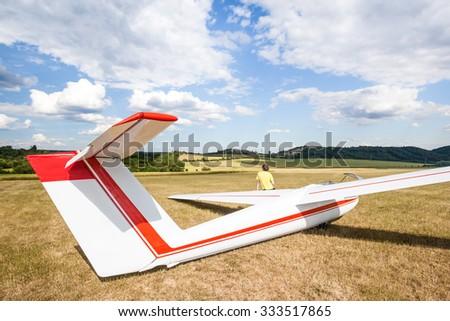 waiting airplane (glider) on runway - stock photo