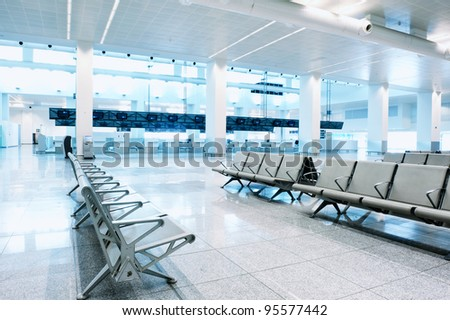 Waiting area in an empty airport terminal - stock photo