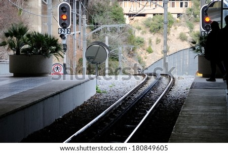 Waiting at a train station - stock photo