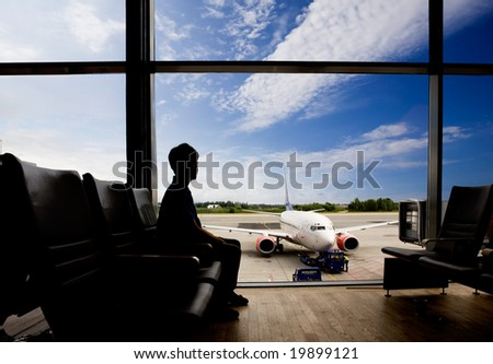 Waiting at airport for flight - stock photo