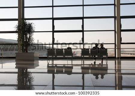 Waiting at the airport (backlit view) - stock photo