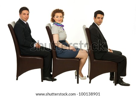 Waiting business people on chairs looking at camera isolated on white background