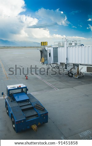 Waiting for airplane in tarmac ready to be boarded by flying passengers and crew - stock photo