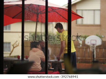 waiting for better weather under the umbrella