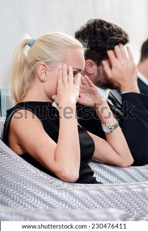 Waiting for hiring. Three candidates for the job in the office sitting on chairs and waiting for their turn. Businesspeople sitting in a row - stock photo