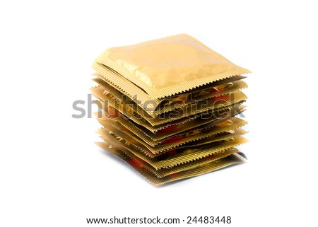 Waiting for long sex: 12 condoms in a stack isolated on white - stock photo